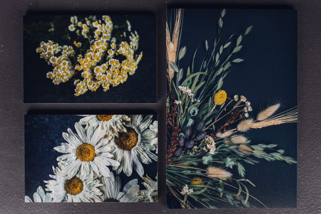 wall art grouping of feverfew daisy and a dried wreath