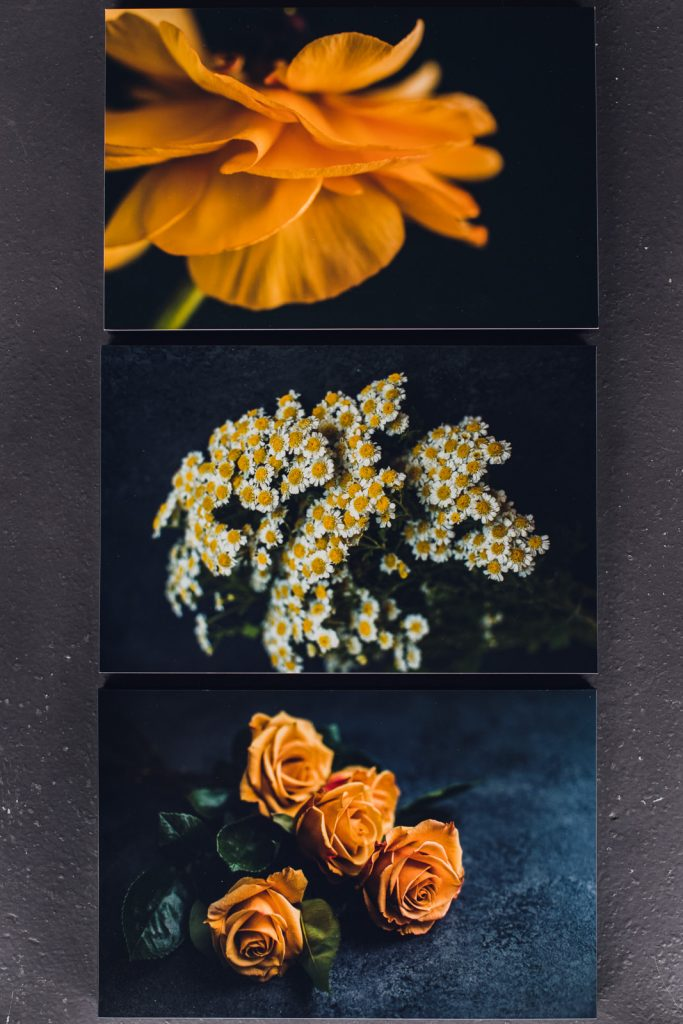 three yellow flowers printed in vertical set as wall art
