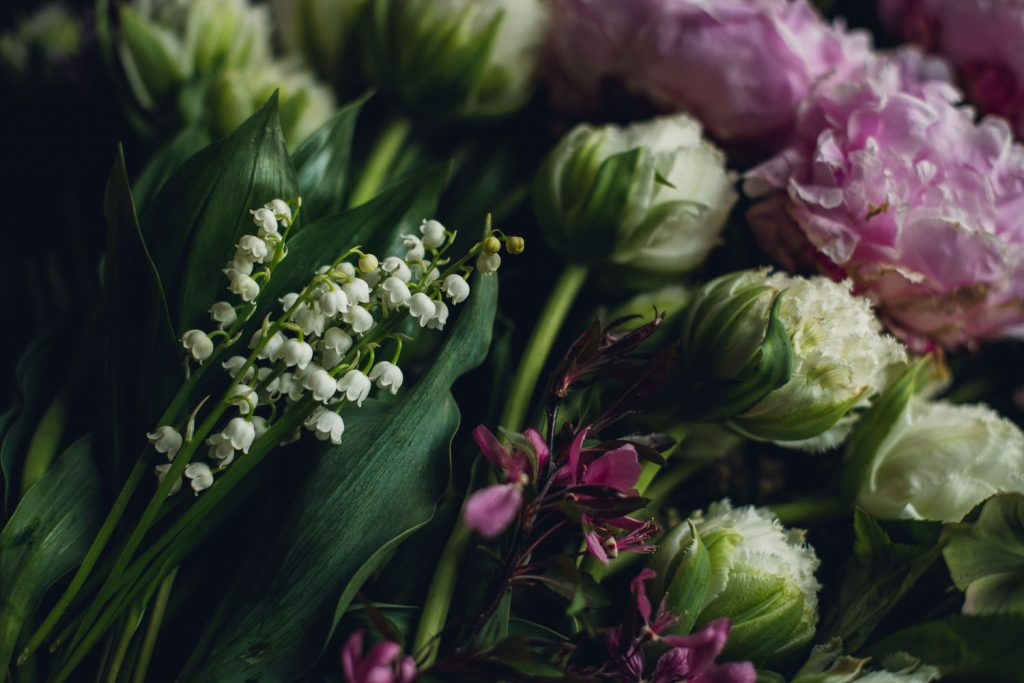 large bunch on flowers including lily of the valley, double novelty tulips, peonies