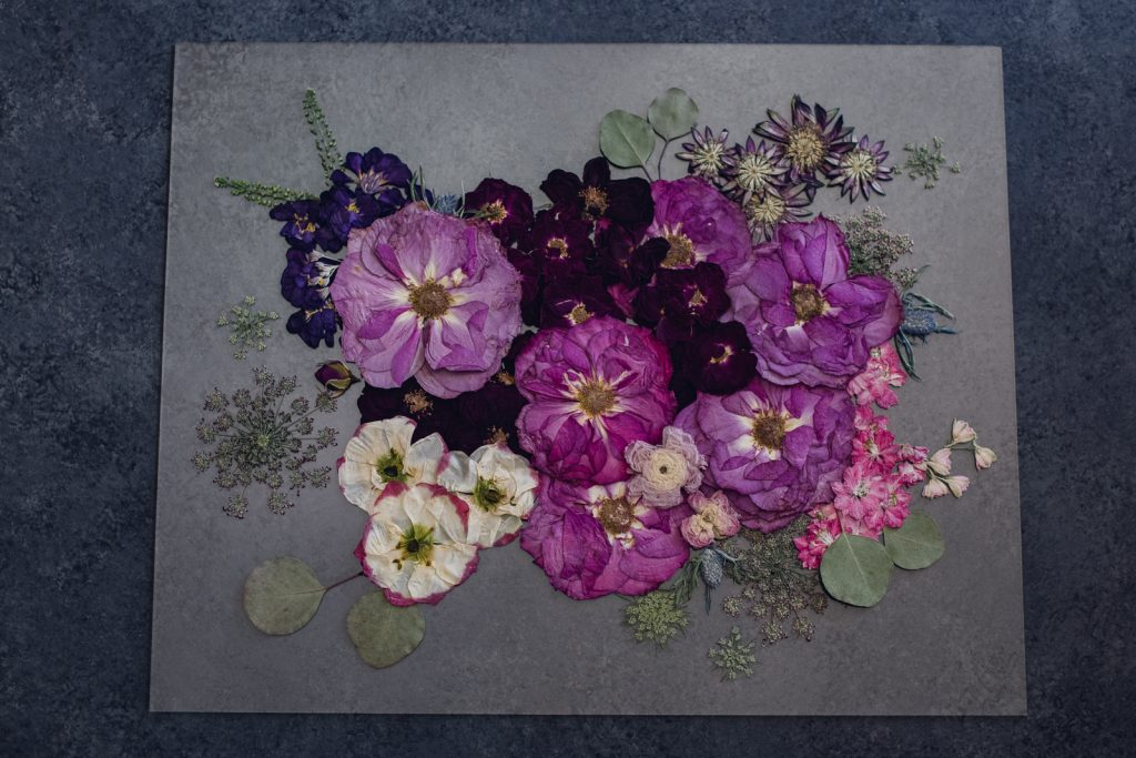 vibrant wedding bouquet flowers pressed into wall art