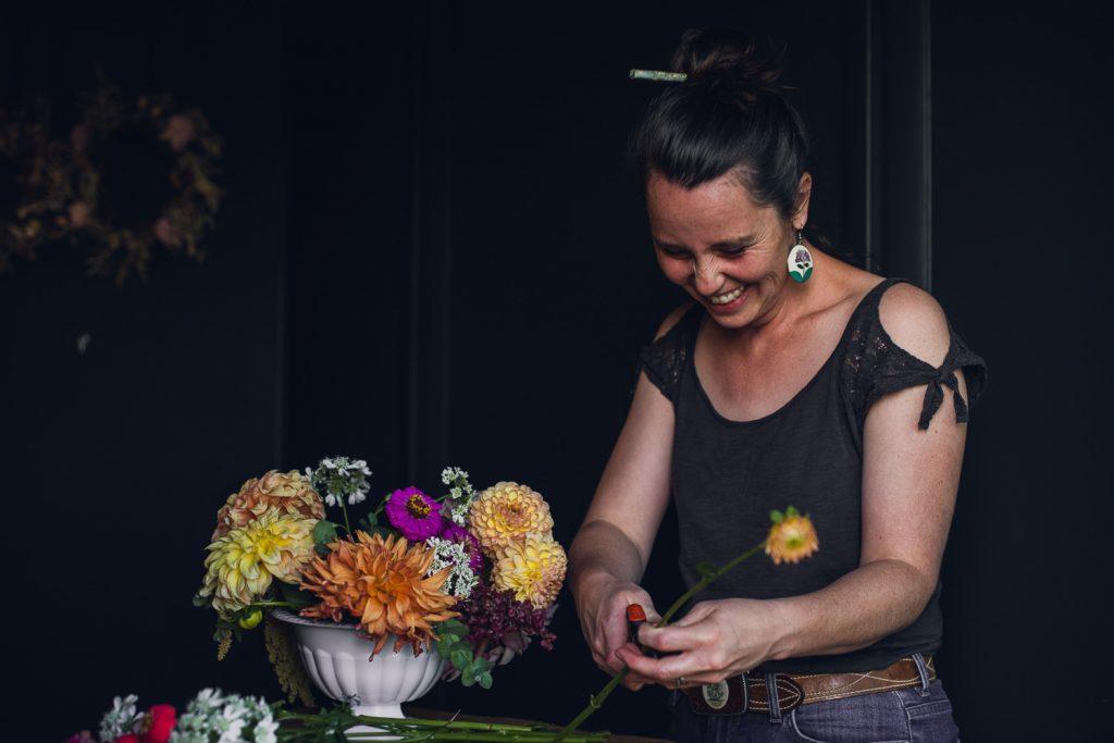 florist working with an autumn dahlia centerpiece
