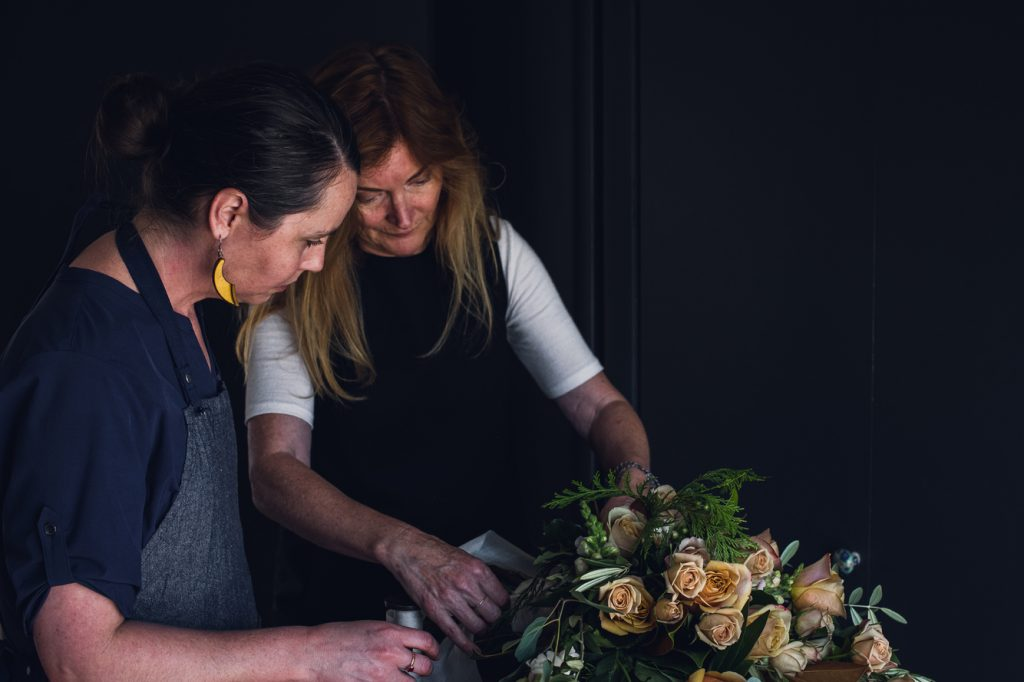 colorado florist teaching a mentorship to new floral designer