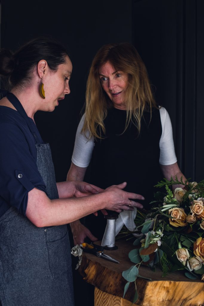 woman teaching a floral design mentorship