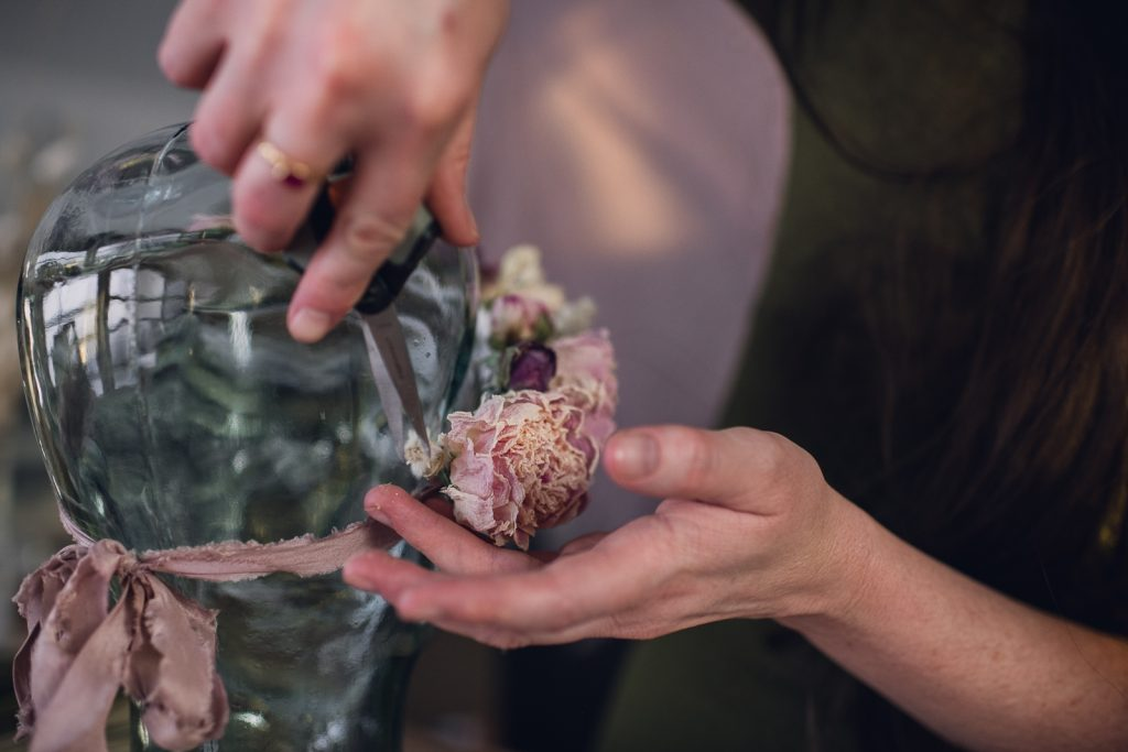 florist creating a dried pink flower crown