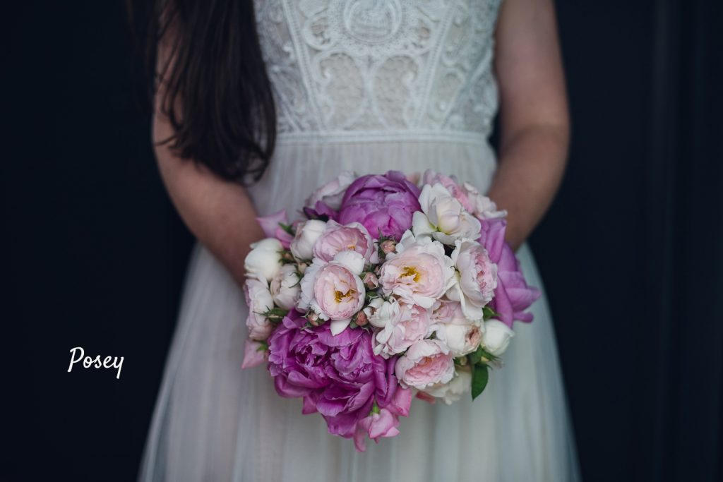 round posey bouquet of magenta peonies and pink