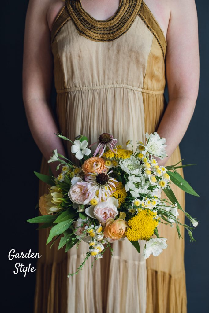 garden style open form bouquet of yellows and greens