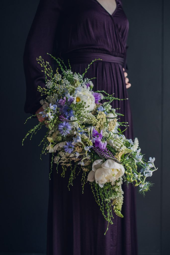 large cascade waterfall bouquet with white blue and purple flower