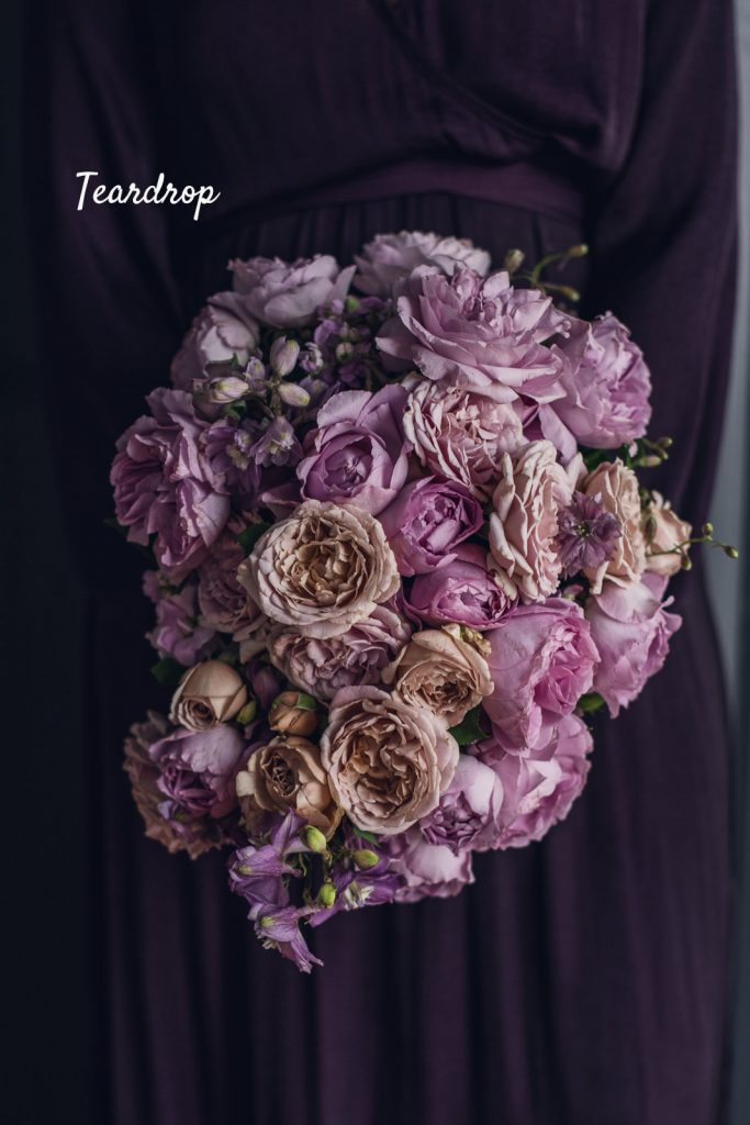 teardrop style bouquet made of pink and peach roses