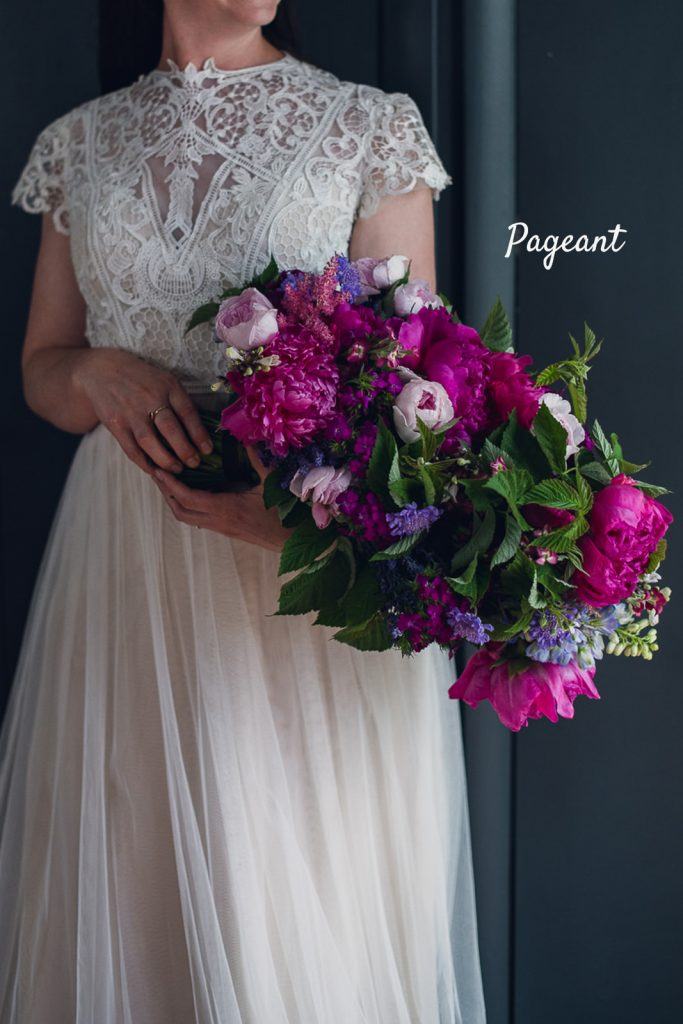 large pageant style bouquet with magenta peonies
