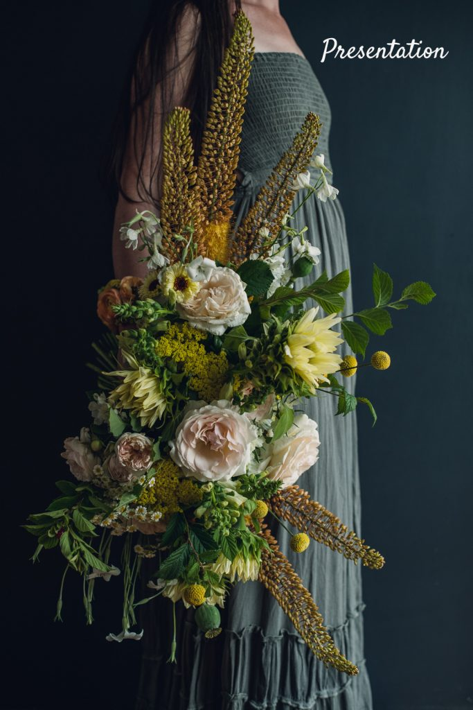 stunning presentation style bouquet with roses and foxtail lilies
