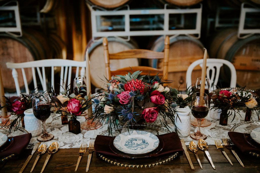 jewel tone wedding tablescape at a winery