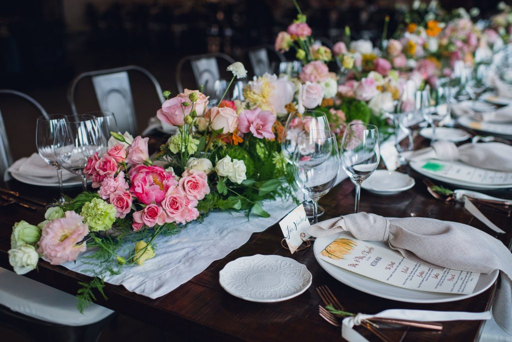 floral table garland in citrus colors at a summer wedding