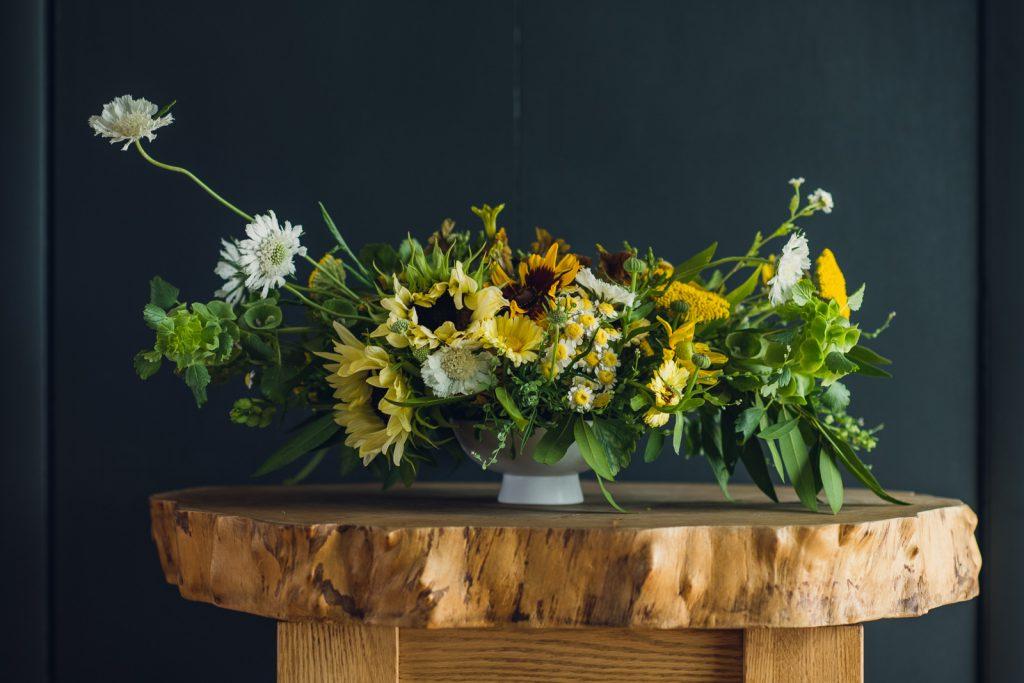wild open form centerpiece with sunflowers